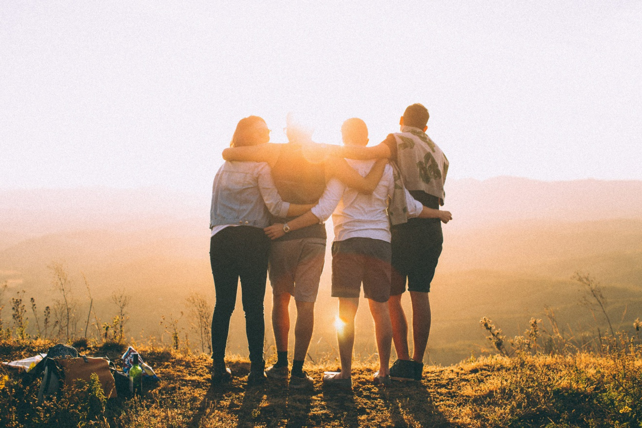 community - group of people hugging