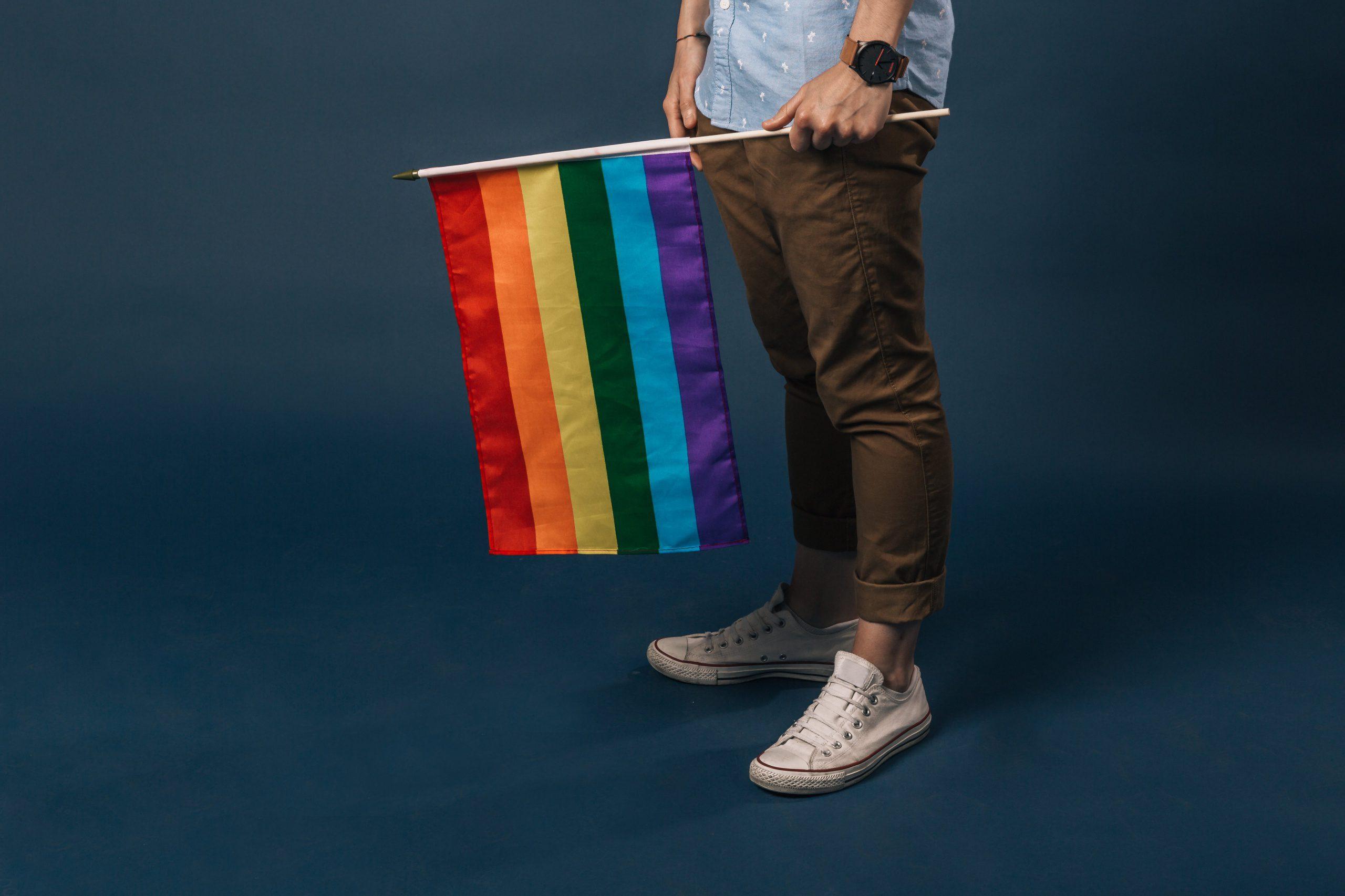 Rainbow flag being held
